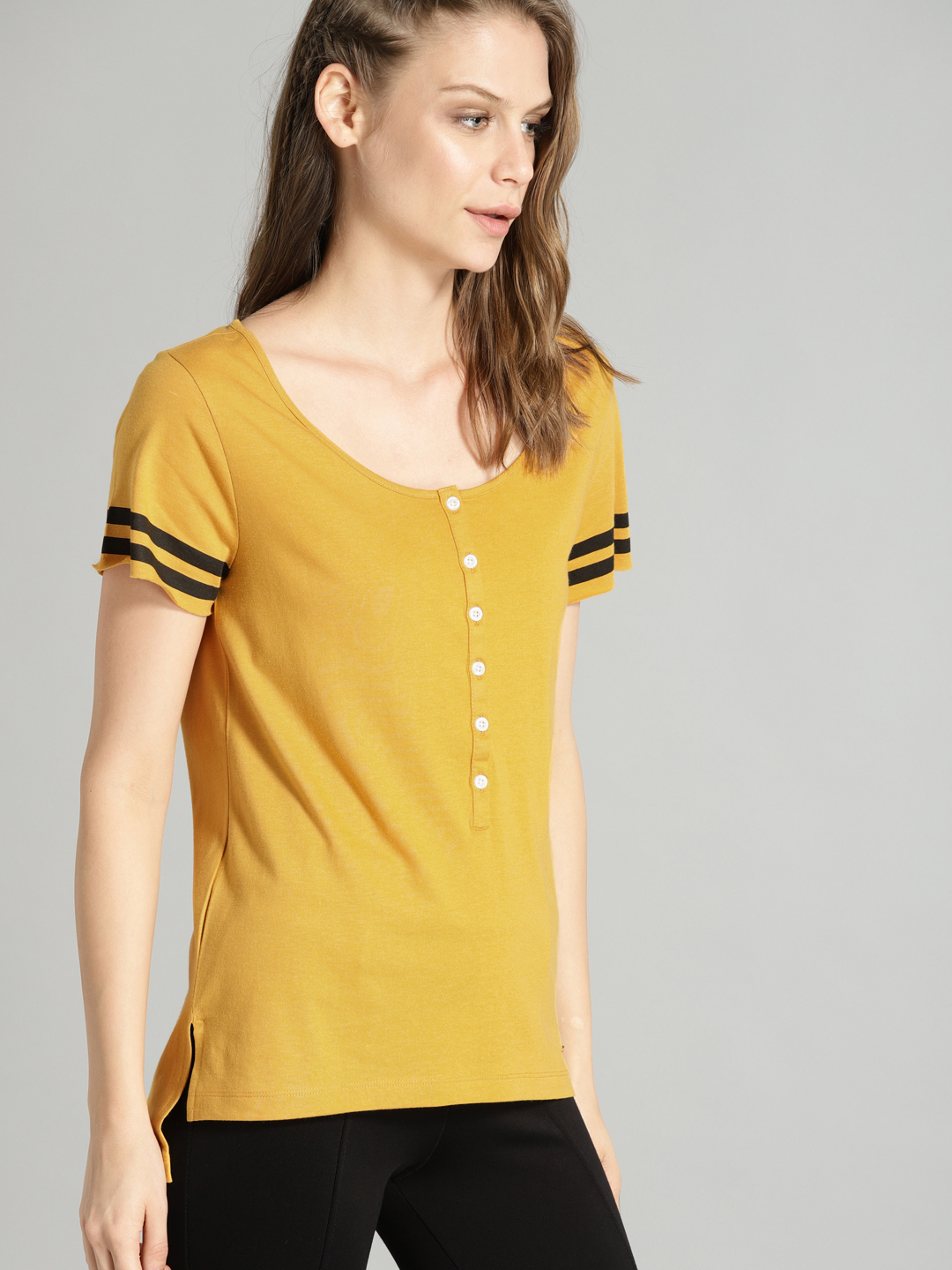 Roadster Women Mustard Yellow Solid T-shirt Price in India