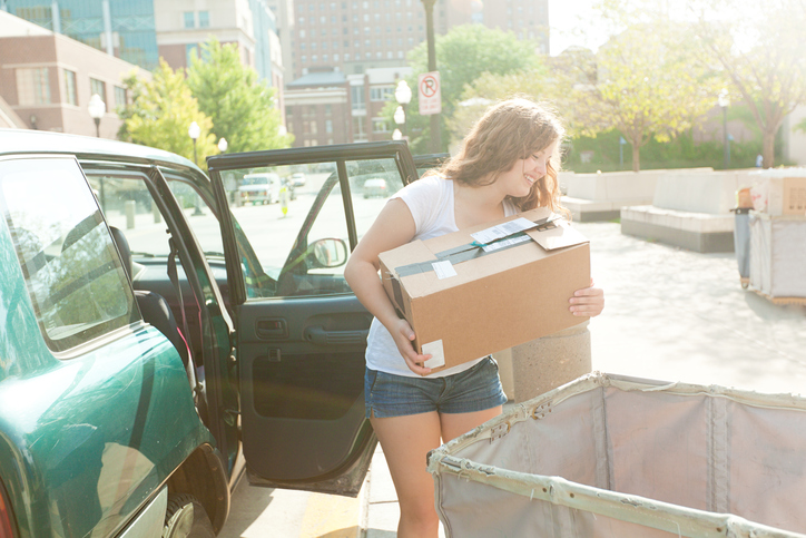 Girl moving in to university halls