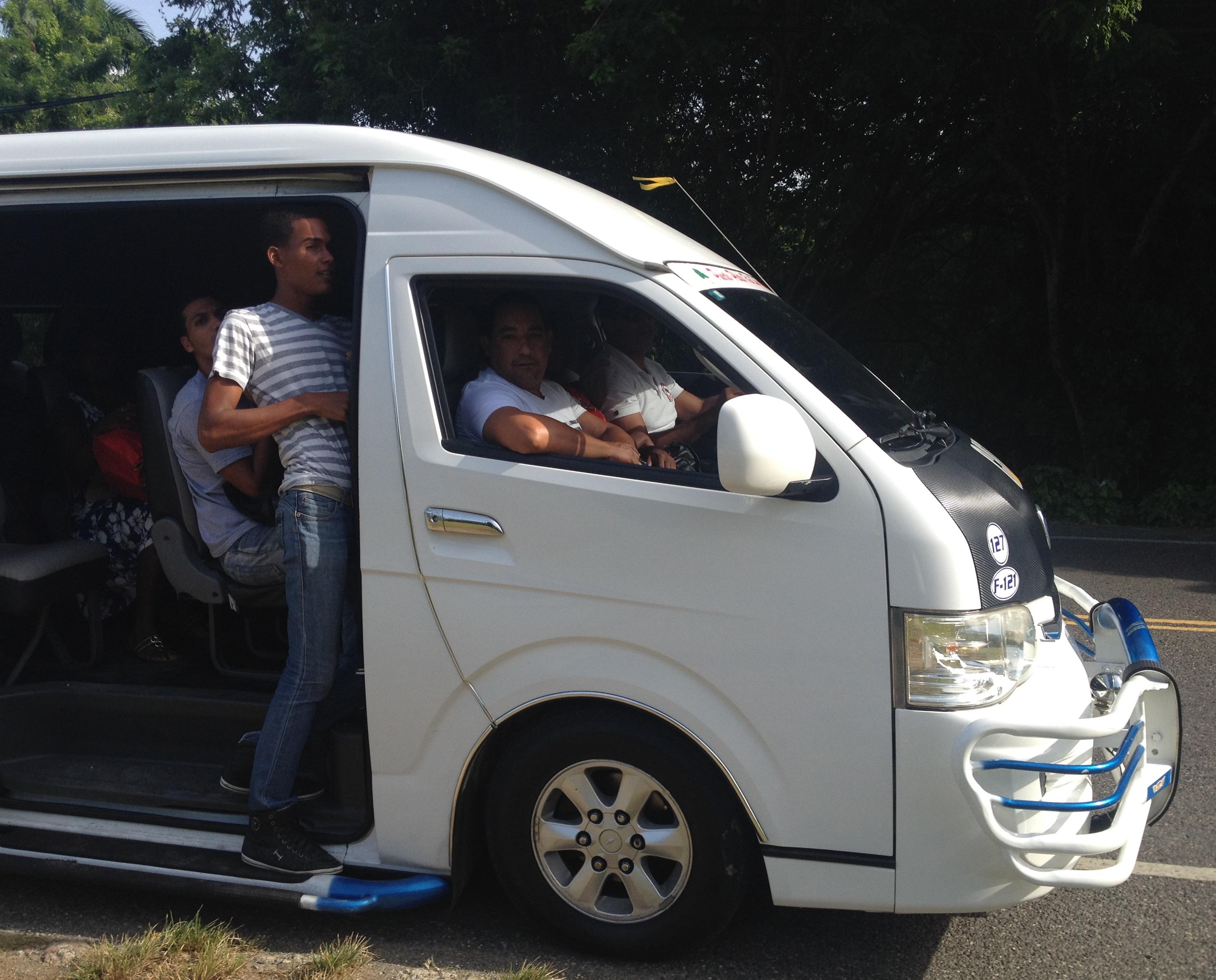 transportation   riding a guagua dominican republic on the scene