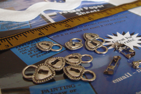 Freezer paper, lock charms, brooch findings and some awesome trim (check out the giant rick rack!)