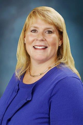 Kelly  Huguenin