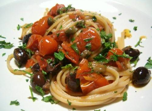 with anchovies, capers, black olives and garlic in a lightly spicy tomato sauce