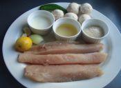 Fricase marino con salsa de champiñones