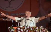 FILE: Indian Prime Minister Narendra Modi & leader of the Bharatiya Janata party gestures as he addresses a state assembly election rally in the village of Andawa on the outskirts of Allahabad on 20 February 2017. Picture: AFP.