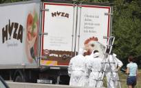 In this file photo taken on 27 August 2015 forensic investigators work on a refrigerated truck parked along a highway near Neusiedl am See, Austria, after the bodies of 71 migrants where found suffocated in the lorry.  Picture: AFP.
