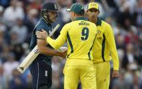 Australia's Shaun Marsh (C) congratulates England's David Willey (L) at the end of the first ODI cricket match between England and Australia at The Oval cricket ground in London on 13 June, 2018. Picture: AFP