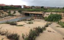 The storm drain where a 14-year-old girl was washed away in a flash flood. Picture: Kgothatso Mogale/EWN.