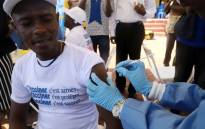 A World Health Organization worker administers a vaccination during the launch of a campaign aimed at beating an outbreak of Ebola in the port city of Mbandaka, Democratic Republic of Congo, on 21 May 2018. Picture: Reuters