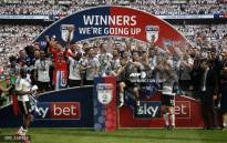 Fulham's players celebrate with the trophy on the pitch after the English Championship play-off final football match between Aston Villa and Fulham at Wembley Stadium in London on May 26, 2018. Fulham won the game 1-0, and are promoted to the Premier League. Picture: AFP.