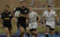Jaguares wing Ramiro Moyano (2-L) runs with the ball during their Super Rugby match against the Sharks at the Jose Amalfitani stadium in Buenos Aires, on 25 May, 2018. Picture: AFP