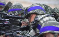 South Korean Marines take a position on a beach during a joint landing operation by US and South Korean Marines in the southeastern port of Pohang on 2 April 2017. Picture: AFP