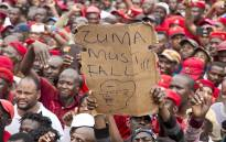 """A protester holds up a placard at the """"Day of Action"""" march against the leadership of President Jacob Zuma held in Pretoria on 12 March 2017. Picture: Reinart Toerien/EWN"""
