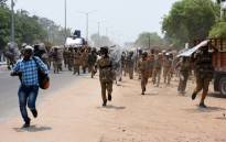 Indian police officials charge towards protesters in the southern Indian city of Tuticorin some 600 kilometres south of Chennai on 22 May 2018, during a protest rally held to demand the closure of a copper factory due to pollution concerns. Picture: AFP.
