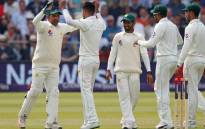 Pakistan cricketers celebrate the fall of a wicket. Picture: AFP