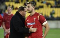 FILE: New Zealand head coach Steve Hansen (L) talks with Wales captain Sam Warburton (R) after the rugby Test match between the New Zealand All Blacks and Wales in Wellington on 18 June 2016.  Picture: AFP.