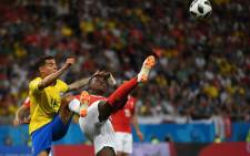 Brazil's forward Philippe Coutinho (L) and Switzerland's forward Breel Embolo compete for the ball during the Russia 2018 World Cup Group E football match between Brazil and Switzerland at the Rostov Arena in Rostov-On-Don on 17 June 2018. Picture: AFP