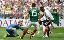 Germany goalkeeper Manuel Neuer makes a save under pressure from his Mexican opponents during their Fifa World Cup match on 17 June 2018. Picture: @DFB_Team_EN/Twitter