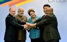 FILE: Russian President Vladimir Putin, India's PM Narendra Modi, Brazilian President Dilma Rousseff, China's President Xi Jinping and South Africa's Jacob Zuma gesture during the 6th BRICS Summit in Fortaleza, Brazil, on 15 July 2014. Picture: AFP.
