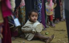 A Rohingya Muslim refugee waits with others for food aid at Thankhali refugee camp in Bangladesh's Ukhia district on 12 January 2018. Picture AFP
