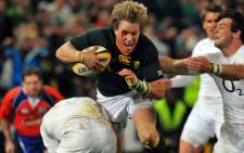 Jean de Villiers tries to score a try and avoids a tacke by England's Mike Brown during the 1st match between South Africa and England at Kings Park Stadium on 9 June. Picture: AFP.