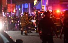 Police officers and firefighters respond to an explosion on 17 September 2016 at 23rd Street between 6th and 7th Avenues in the Chelsea neighborhood of New York City. Picture: Getty Images/AFP.