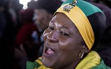 An ANC supporter sings ahead of President Jacob Zuma's election campaign address in Thembelihle, south of Johannesburg on 30 June 2016. Picture: Reinart Toerien/EWN.
