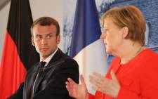 French President Emmanuel Macron (L) and German Chancellor Angela Merkel give a joint press conference on 19 June 2018, at the Meseberg Palace, northeastern Germany. Picture: AFP
