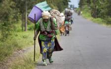 Villagers flee their homes in Sake, in the Democratic Republic of the Congo's North Kivu province, as fighting erupts between FARDC Government forces and rebel groups. Picture: United Nations Photo.