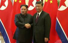 Chinese President Xi Jinping and North Korean leader Kim Jong Un shaking hands during their meeting in Beijing on 27 March 2018. Picture: AFP.