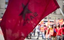An SACP flag flies outside National Treasury in Pretoria on 21 April 2017. Picture: EWN