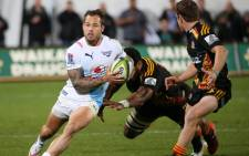 Francois Hougaard (left) of the Northern Bulls looks to step past Waikato Chiefs' Brad Weber (right) during a Super 15 rugby match in Rotorua on May 22, 2015. Picture: AFP.""