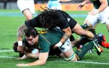 Ma'a Nonu of New Zealand fails to stop Francois Louw of South Africa as he scores a try during the Rugby Championship Test rugby union match between the New Zealand All Blacks and South Africa Springboks at Eden Park in Auckland on September 14 2013. Picture: Michael Bradley/AFP