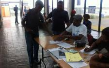 A man registers to vote at Mew Way Hall in Khayelitsha on 8 February. Picture: Siyabonga Sesant/EWN.