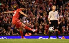 Liverpool's Spanish midfielder Suso scores Liverpool's final penalty during their 14-13 penalty shoot out victory in the English League Cup third round football match between Liverpool and Middlesbrough. Picture: AFP