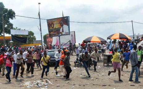 Protesters run after Democratic Republic of Congo's soldiers opened fire to disperse a crowd of demonstrators on 20 January 2015 in Kinshasa. Picture: AFP.