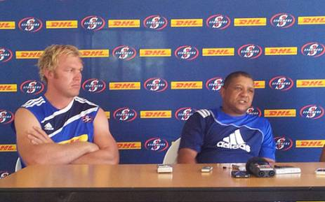 Stormers player Schalk Burger sits with coach Allister Coetzee during a press conference on 16 January 2013. Picture: Alicia Pillay/EWN