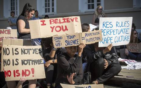 UCT students hold up posters during a protest against rape and sexual abuse on campus on 11 May 2016. Picture: Thomas Holder/EWN.