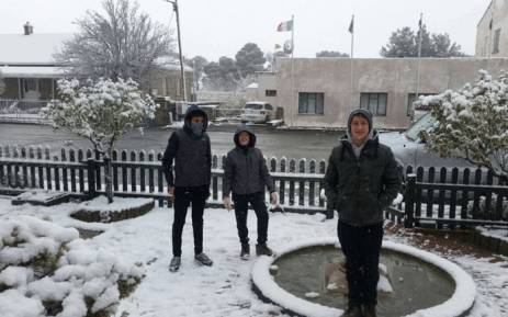 Several people gathered in Sutherland to witness the snow in the Northern Cape town. Picture: Juanita Hutchings