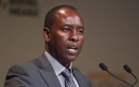 FILE: Minister of Mineral Resources Mosebenzi Zwane addresses the first day of the Mining Indaba 2016 conference in Cape Town. Picture: AFP