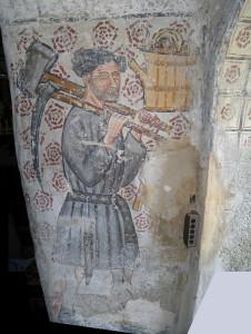 8.Affresco nell'arco della cappella di Marseiller (Verrayes) raffigurante un addetto allo scavo o alla manutenzione del Ru de Marseiller. Giacomino d'Ivrea, 1441.