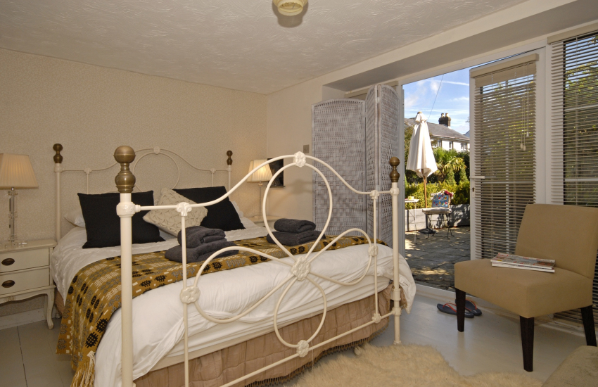 Llanybri holiday cottage - king size bedroom with French doors to terrace