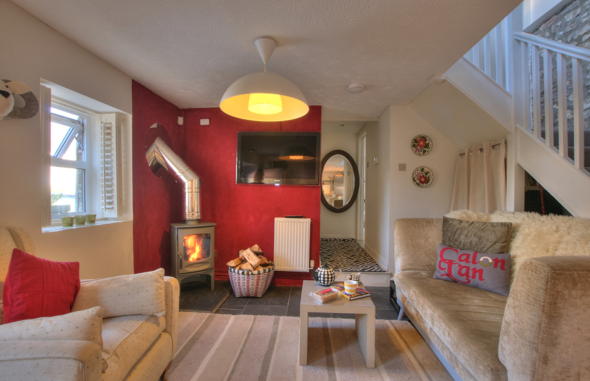 Llansteffan cosy holiday cottage - kitchen sitting room with log burning stove