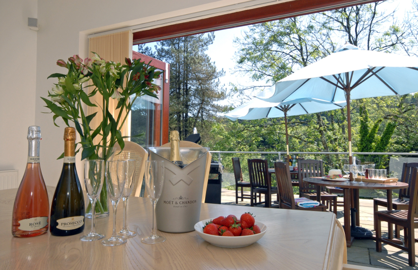 Dining area with bi fold doors to the terrace