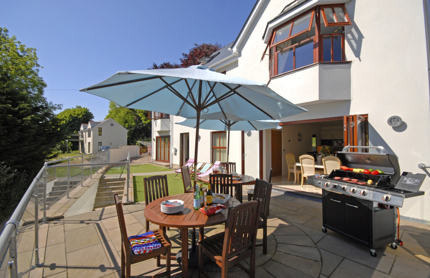 Terrace area with BBQ and ample seating for 10 guests