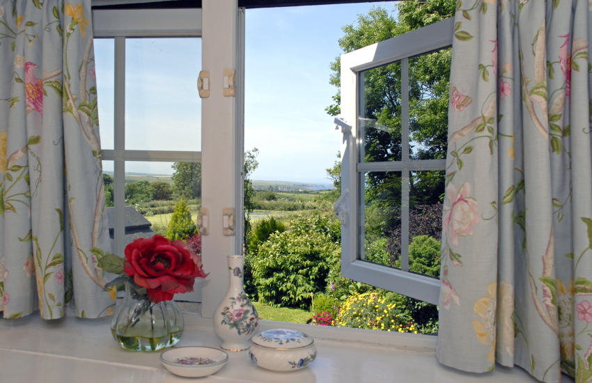 Views over the gardens to the coast from the bedroom