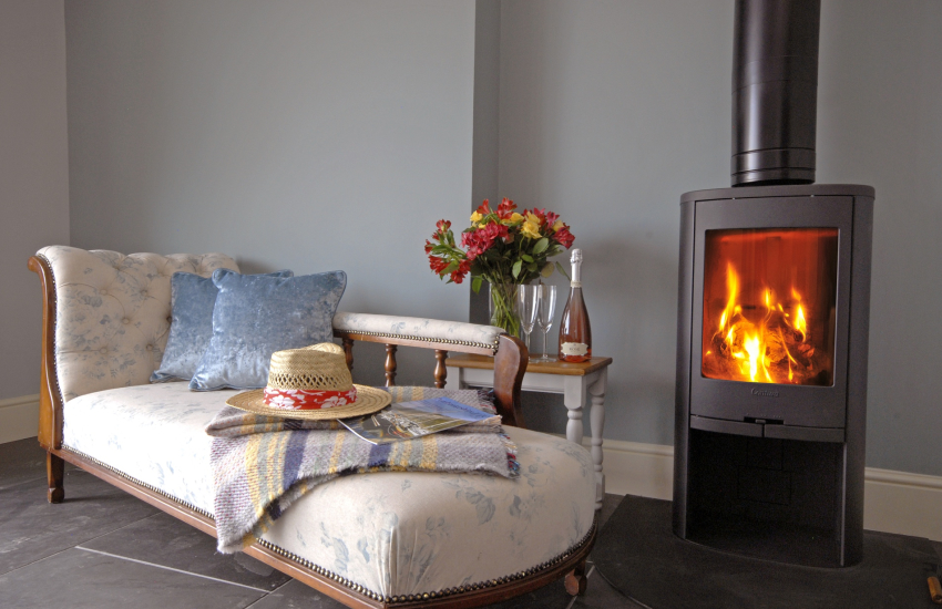 Relax on the Chaise lounge by the wood burning stove