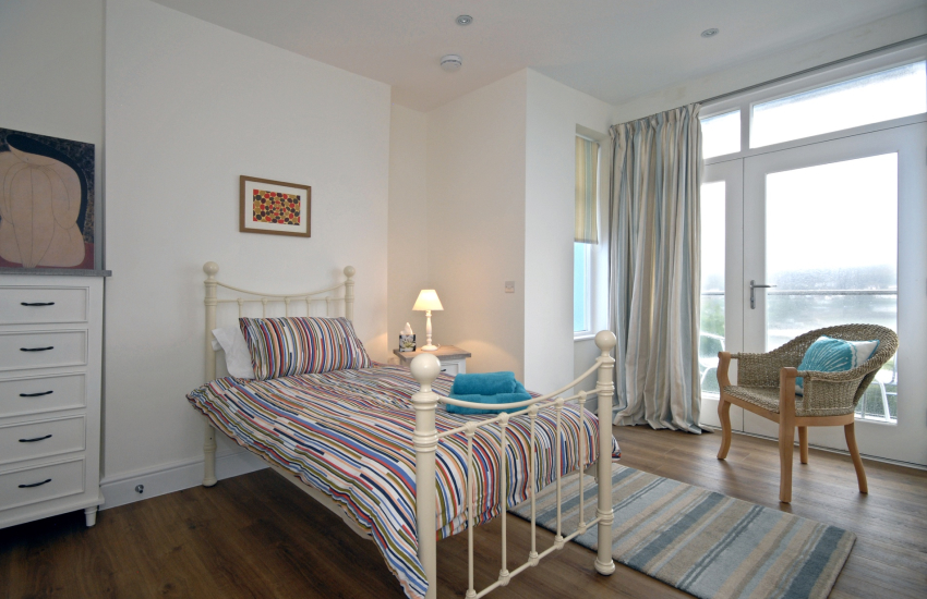Ground floor single with en suite shower and balcony