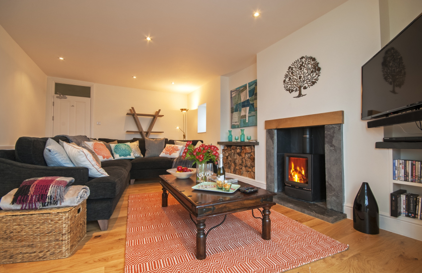 Sitting room with wood burning stove and harbour views