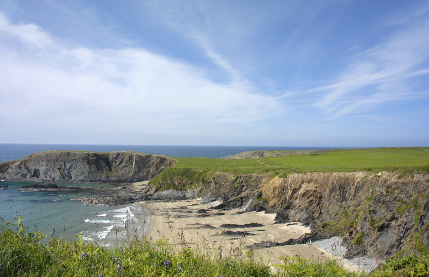 Traeth Llyfn, a remote beach backed by towering cliffs
