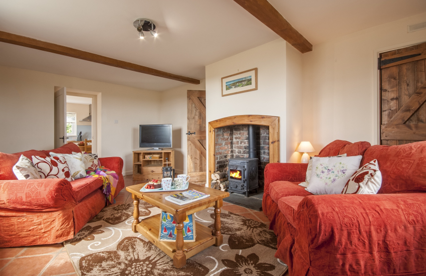 Whitesands Bay holiday home - cosy sitting room with log burning stove